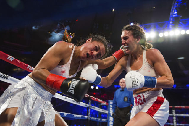 Mikaela Mayer, right, connects with Baby Nansen during their lightweight boxing bout Saturday, May 12, 2018, in New York. (AP Photo/Kevin Hagen)