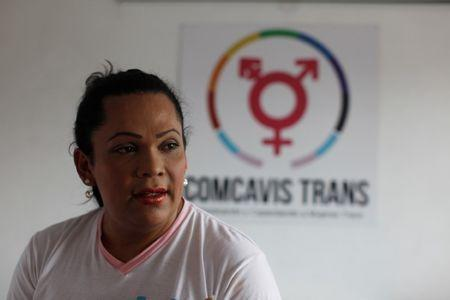 Karla Avelar, executive director of the Association for Communicating and Training Trans Women (COMCAVIS TRANS), pose for a picture at her office in San Salvador, El Salvador, May 12, 2017. REUTERS/Jose Cabezas