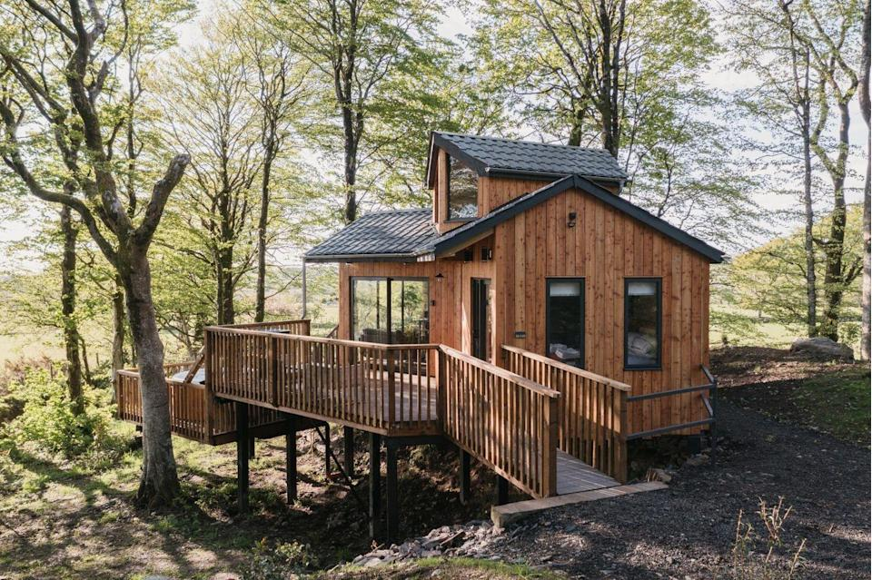 """<p>Tucked away in West Wales sits this stunning treehouse property that is so beautiful, you'd think it was from your childhood fantasies. </p><p>A self-catering treehouse with a wood-fired pizza oven, WiFi (but digital detoxing is advised!) and an outdoor cedar clad hot tub, we wouldn't blame you if you wanted to stay in this Scandi chic hideaway for the duration of your stay. We're big fans of the living area with views of the sea in the distance, as well as the soft furnishings and windows aplenty. </p><p>If you did want to venture out to the wilderness to stretch your legs and work up an appetite, eight miles down the road is Ceredigion coastline, the harbour town of Aberaeron and the Cambrian Mountains. The words 'I'm bored' are strictly a no-no. </p><p><a class=""""link rapid-noclick-resp"""" href=""""https://thewanderlist.uk/properties/cuckoos-hideaway/"""" rel=""""nofollow noopener"""" target=""""_blank"""" data-ylk=""""slk:BOOK HERE"""">BOOK HERE</a> </p>"""
