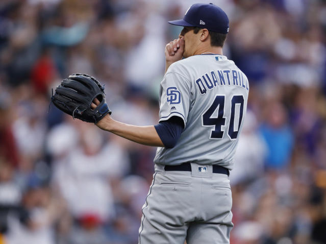 San Diego Padres starting pitcher Cal Quantrill waits for a new ball after giving up a two-run home run to Colorado Rockies' David Dahl during the third inning of a baseball game Friday, June 14, 2019, in Denver. (AP Photo/David Zalubowski)