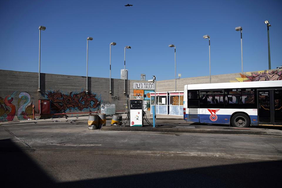 A bus near a gasoline pump on the upper floor of the Central Bus Station on Feb. 3. (Photo: Corinna Kern/Reuters)