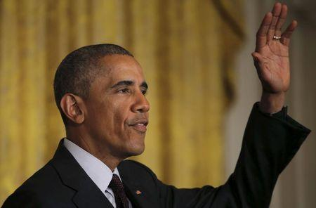U.S. President Barack Obama waves after delivering remarks at a reception celebrating the signing into law of the African Growth and Opportunity Act at the East Room of the White House in Washington July 22, 2015. REUTERS/Carlos Barria