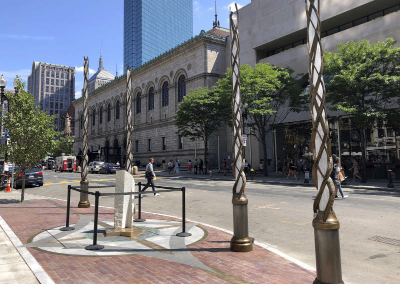 Light spires and one of the stone pillars stand along Boylston Street after installation was finished, Monday, Aug. 19, 2019, in Boston to memorialize the Boston Marathon bombing victims at the sites where they were killed. Martin Richard, Krystle Campbell and Lingzi Lu were killed when bombs were detonated at two locations near the finish line on April 15, 2013. (AP Photo/Philip Marcelo)