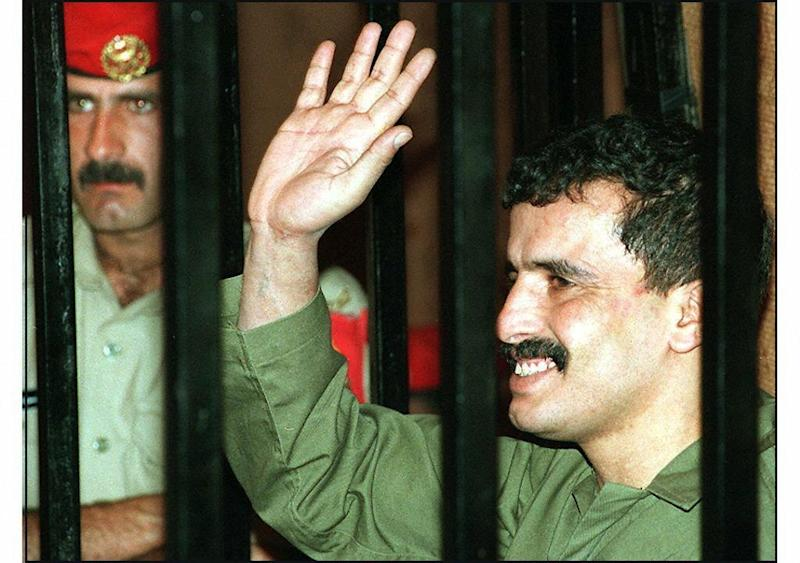 Jordanian soldier Ahmad Dakamseh waves to relatives in court on June 25, 1997 before being sentenced to 20 years for killing seven Israeli schoolgirls earlier the same year (AFP Photo/JAMAL NASRALLAH)