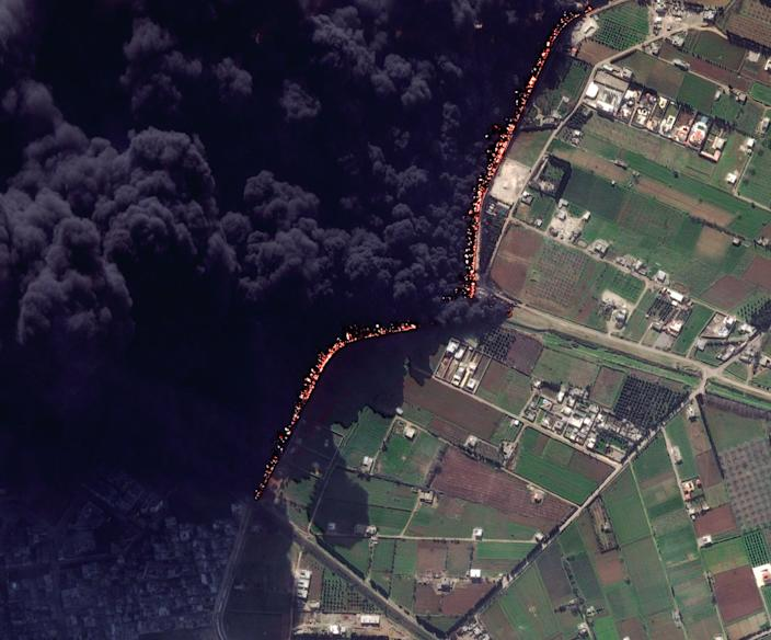 """This Wednesday Feb. 15, 2012 satellite image shows a pipeline fire in Homs, Syria. The pipeline, which runs through the rebel-held neighborhood of Baba Amr, in Homs, had been shelled by regime troops for the previous 12 days, according to two activist groups, the Local Coordination Committees and the Britain-based Syrian Observatory for Human Rights. The state news agency, SANA, blamed """"armed terrorists"""" for the pipeline attack last week. It said the pipeline feeds the tankers in the Damascus suburb of Adra, which contribute in supplying gasoline to the capital and southern regions. (AP Photo/DigitalGlobe) MANDATORY CREDIT"""
