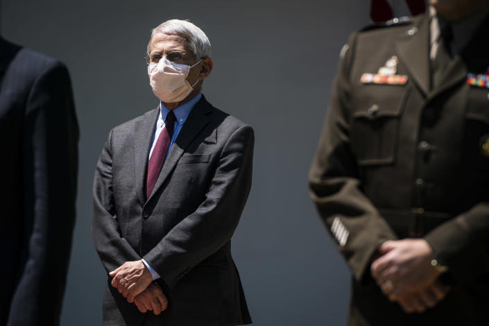 Director of the National Institute of Allergy and Infectious Diseases Dr. Anthony Fauci, wearing a face mask, listens as President Donald J. Trump participates in a vaccine development event in the Rose Garden at the White House on Friday, May 15, 2020 in Washington, DC. (Jabin Botsford/The Washington Post via Getty Images)