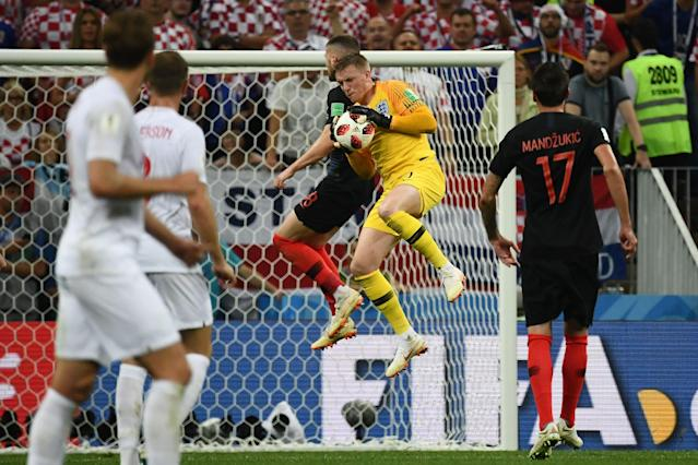 <p>England's goalkeeper Jordan Pickford (2nd-R) catches the ball ahead of Croatia's forward Ante Rebic (C) during the Russia 2018 World Cup semi-final football match between Croatia and England at the Luzhniki Stadium in Moscow on July 11, 2018. (Photo by FRANCK FIFE / AFP) </p>