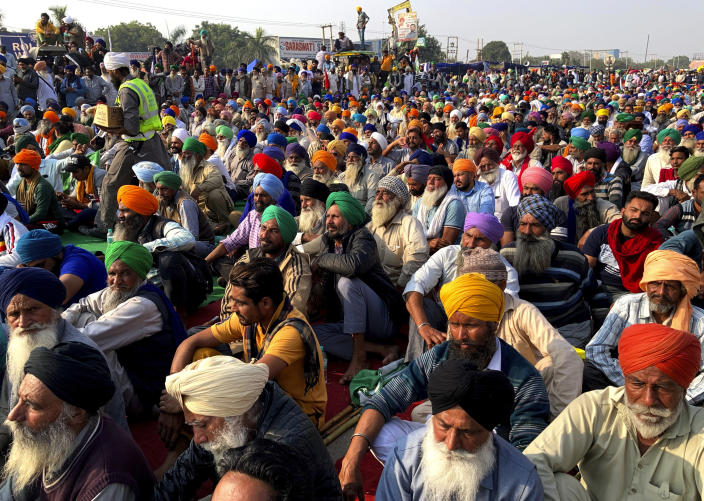 Indian farmers protesting new agriculture laws hold a meeting at the Delhi-Haryana state border, Monday, Nov. 30, 2020. Indian Prime Minister Narendra Modi tried to placate thousands of farmers protesting new agriculture laws Monday and said they were being misled by opposition parties and that his government would resolve all their concerns. (AP Photo/Rishi Lekhi)