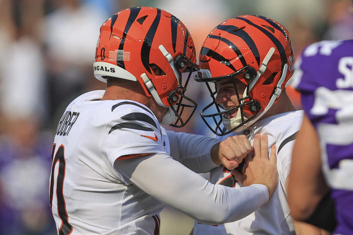 Cincinnati Bengals kicker Evan McPherson, right, celebrates with holder Kevin Huber, left, after making a field goal to defeat the Minnesota Vikings during overtime of an NFL football game, Sunday, Sept. 12, 2021, in Cincinnati. (AP Photo/Aaron Doster)