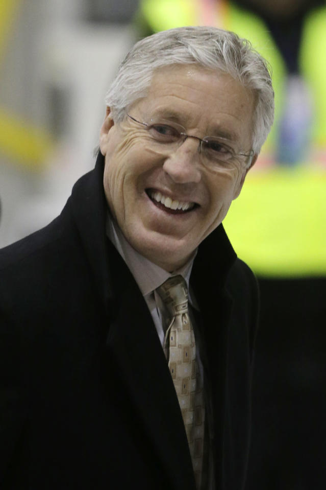 Seattle Seahawks head coach Pete Carroll smiles after arriving at Newark Liberty International Airport for the NFL Super Bowl XLVIII football game, Sunday, Jan. 26, 2014, in Newark, N.J. (AP Photo/Mel Evans)