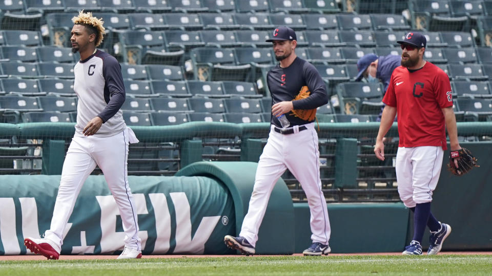 Cleveland Indians relief pitchers, from left, Emmanuel Clase, Nick Wittgren and Bryan Shaw walk off the field after the a baseball game between the Toronto Blue Jays and the Cleveland Indians was postponed due to inclement weather, Saturday, May 29, 2021, in Cleveland. The game will be rescheduled as a traditional doubleheader Sunday. (AP Photo/Tony Dejak)