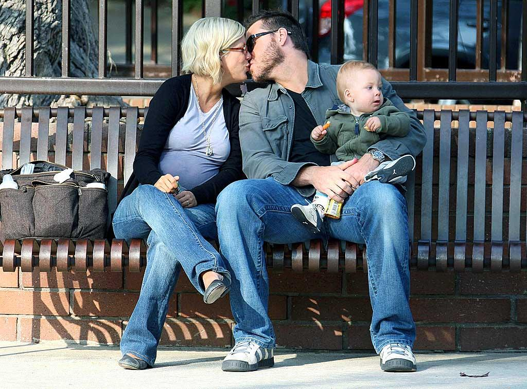 """Meanwhile, little Liam looks elsewhere while his parents Tori Spelling and Dean McDermott engage in some PDA. <a href=""""http://www.infdaily.com"""" target=""""new"""">INFDaily.com</a> - April 5, 2008"""