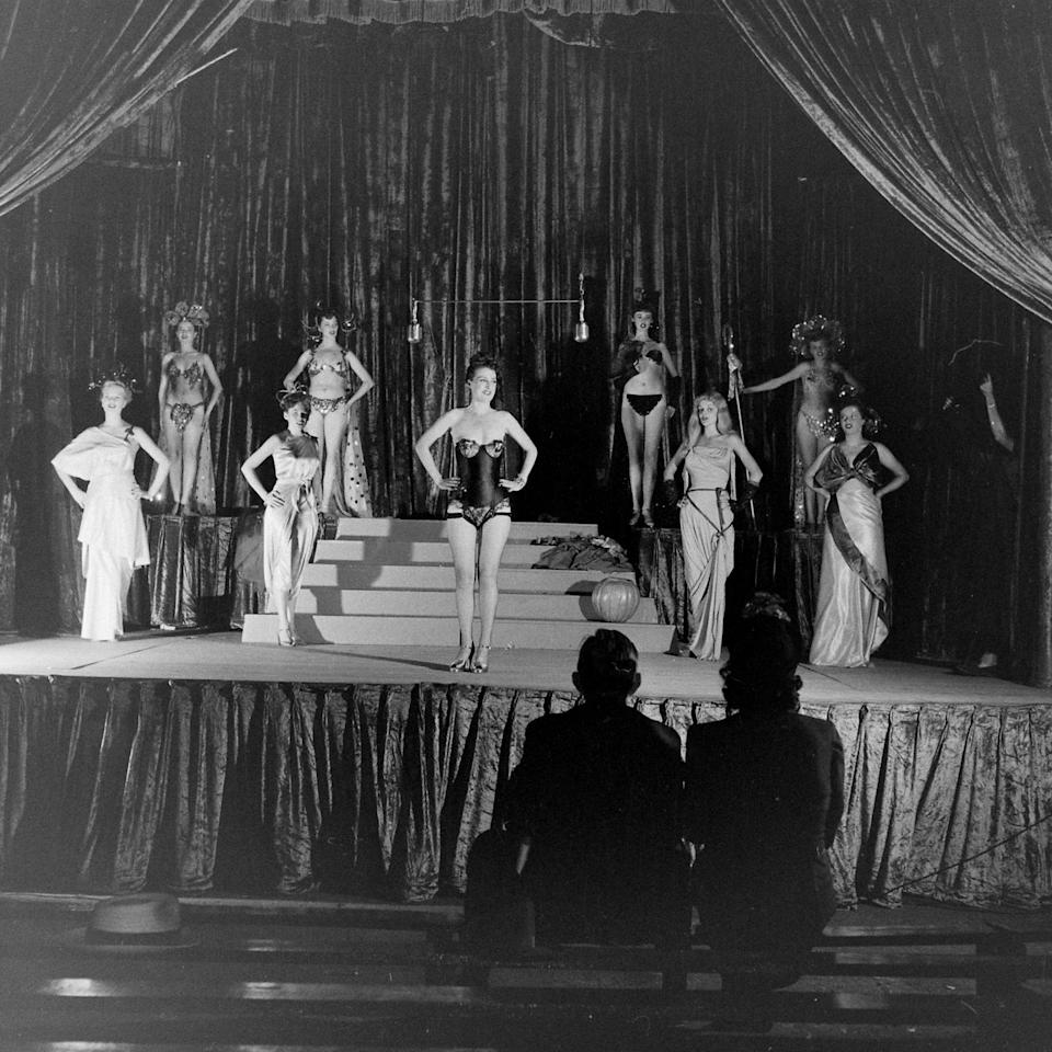 "<p>The origins of shameless thong showing began with <a href=""https://www.crfashionbook.com/culture/g22747653/burlesque-history-vintage/"" target=""_blank"">burlesque</a> dancers in the 1930s as part of their performance costumes. </p>"
