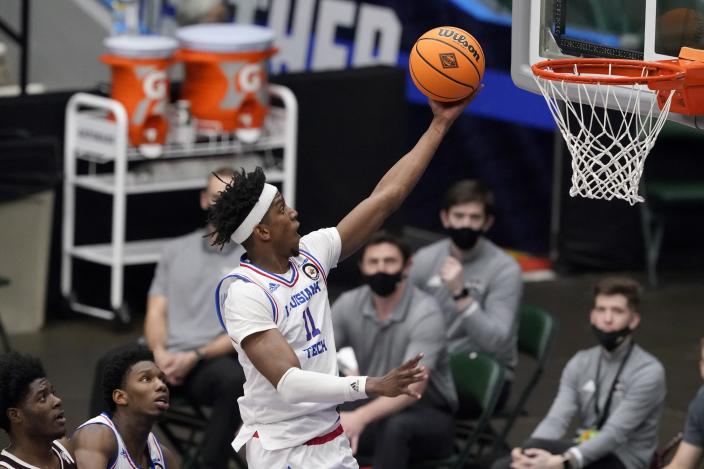 Louisiana Tech guard JaColby Pemberton (11) leaps to the basket for a shot in the first half of an NCAA college basketball game against Mississippi State in the semifinals of the NIT, Saturday, March 27, 2021, in Frisco, Texas. (AP Photo/Tony Gutierrez)