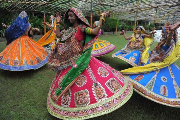 Indian folk dancers from the Zanzar Performing Arts perform during a full dress rehearsal for the forthcoming Navratri festivities or Dance Festival of Nine Nights in Ahmedabad on September 15, 2011. Navratri festival begins from September 28 to October 6, 2011. AFP PHOTO / Sam PANTHAKY