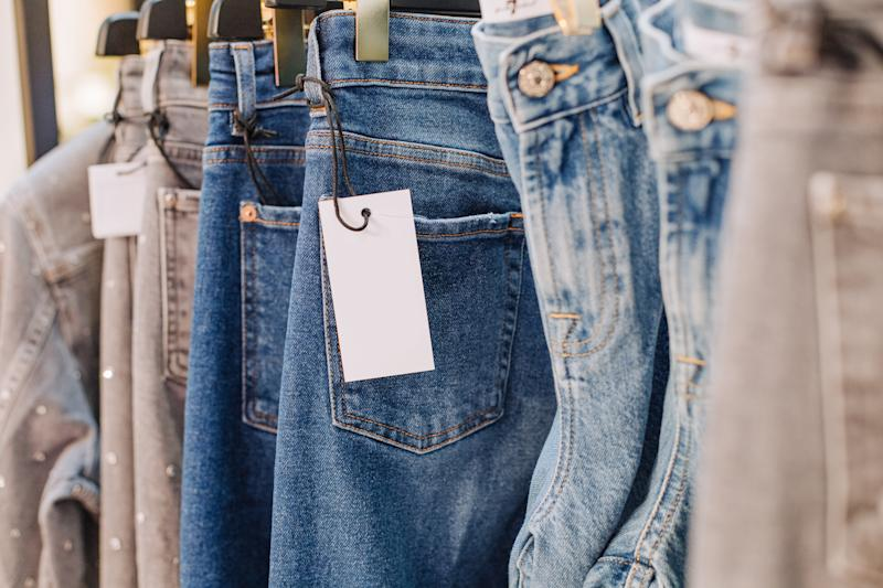 sale assortment denim collection on the stand in a stylish boutique shop selection