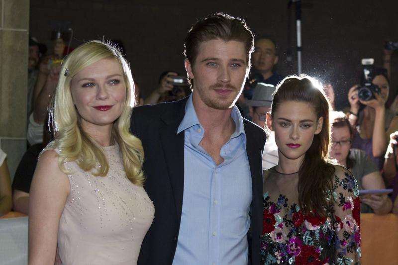 """Kristen Stewart (right) is shown on the red carpet with co-stars Kirsten Dunst (left) and Garrett Hedlund at the gala premiere for the movie """"On the Road"""" during the 2012 Toronto International Film Festival in Toronto on Thursday, Sept. 6, 2012. (AP Photo/The Canadian Press, Chris Young)"""
