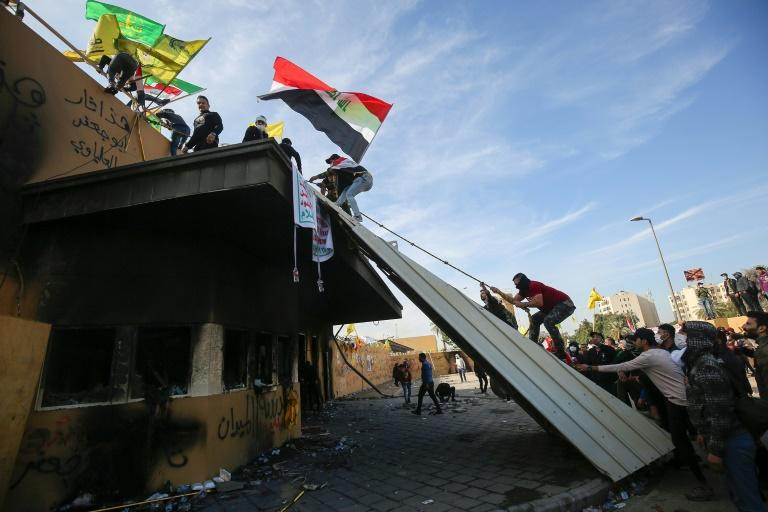 Supporters and members of the Hashed al-Shaabi paramilitary force  gather during a demonstration outside the US embassy in the Iraqi capital Baghdad