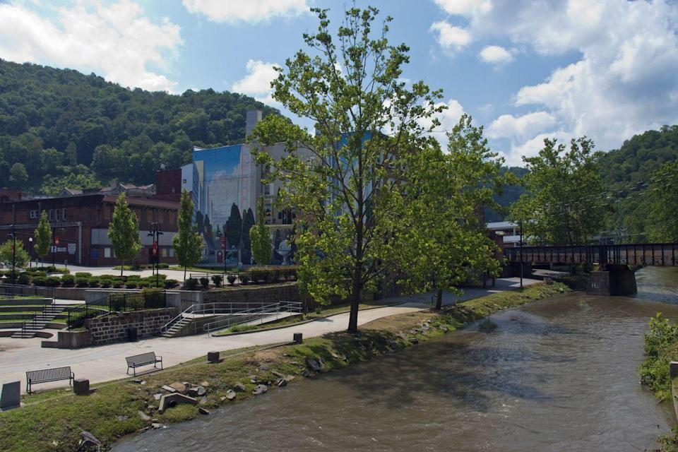 """<p><a href=""""https://www.tripadvisor.com/Tourism-g59630-Welch_West_Virginia-Vacations.html"""" rel=""""nofollow noopener"""" target=""""_blank"""" data-ylk=""""slk:This town"""" class=""""link rapid-noclick-resp"""">This town</a> used to be all about coal mining, but today it's rich in history thanks to the Kimball War Memorial. We recommend grabbing a bite and sitting next to the Elkhorn Creek that flows through the town and into the Tug Fort.</p>"""