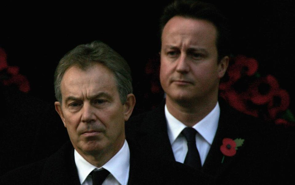 LONDON - NOVEMBER 12:  Britain's Prime Minister Tony Blair (L) and leader of the Conservative Party David Cameron arrive to attend the Remembrance Sunday Service at The Cenotaph on November 12, 2006 in London, England. The Festival of Remembrance is an annual event to honour those who have paid the ultimate sacrifice in the service of their country. The Festival comprises a service of Remembrance and an observance of the Two Minute Silence. It is also an opportunity to think about the Service men and women around the world who are putting their lives at risk protecting our peace and freedom today.  (Photo by Scott Barbour/Getty Images)