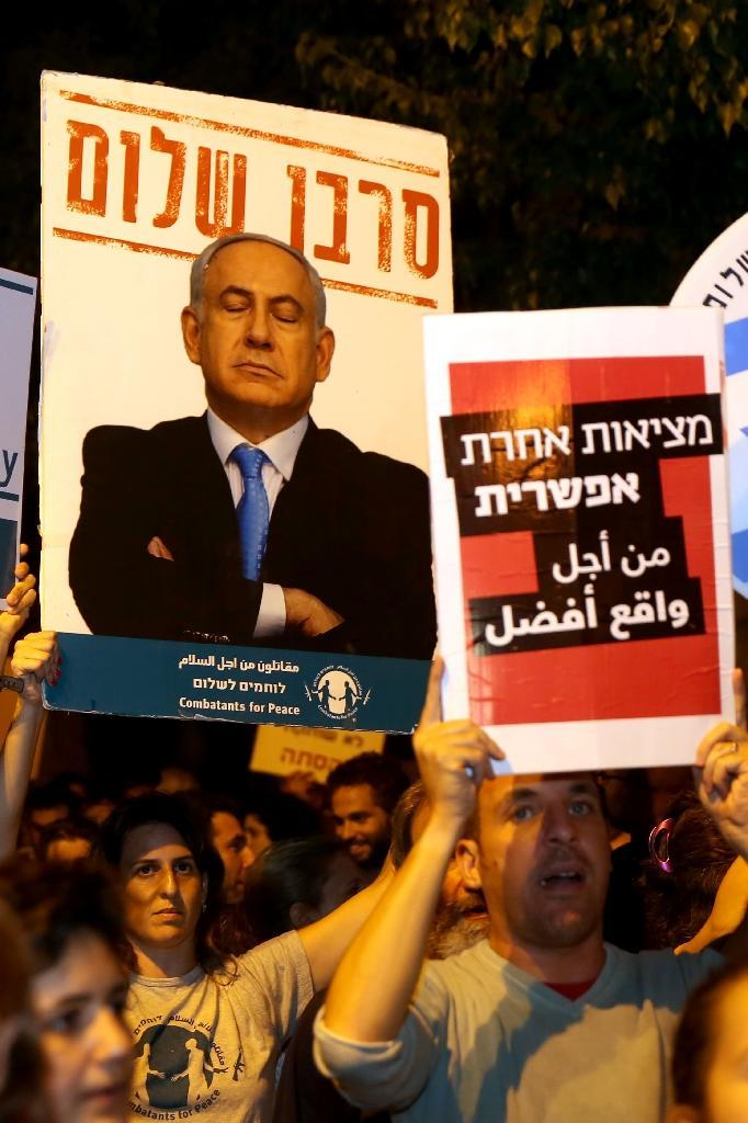 Israeli Jews and Arabs march together in downtown Jerusalem on October 17, 2015, during a left wing protest against the security situation (AFP Photo/Gali Tibbon)