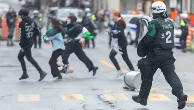Pro-Palestinian protesters run from police following a demonstration in Montreal on Sunday.