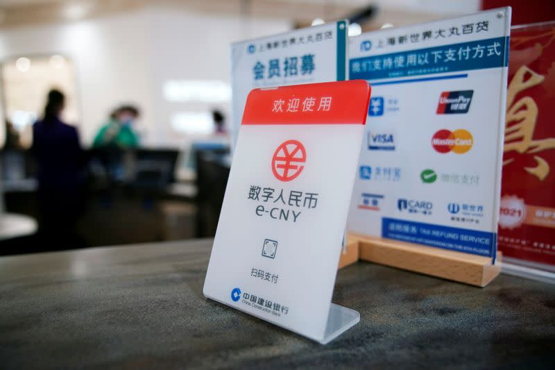 A sign indicating digital yuan, also referred to as e-CNY, is pictured at a shopping mall in Shanghai, China