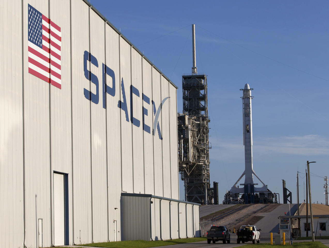 In this photo provided by NASA, a SpaceX Falcon 9 rocket and Dragon spacecraft await liftoff from NASA Kennedy Space Center's Launch Complex 39A in Cape Canaveral, Fla., on Monday, Aug. 14, 2017. SpaceX is about to launch a few tons of research to the International Space Station — plus ice cream. (Kim Shiflett/NASA via AP)