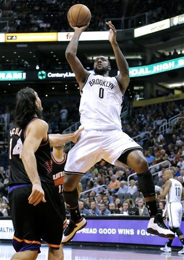 Brooklyn Nets' Andray Blatche (0) shoots over Phoenix Suns' Luis Scola (14), of Argentina, during the first half of an NBA basketball game, Sunday, March 24, 2013, in Phoenix. (AP Photo/Matt York)