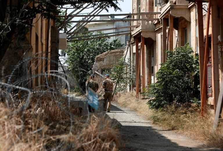 United Nations Peacekeeping Force in Cyprus (UNFICYP) officers patrol inside the buffer zone that slices between the internationally recognised Republic of Cyprus and the Turkish-occupied north, in Nicosia on June 14, 2018