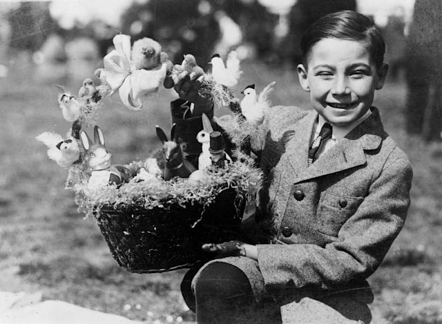 <p>Warren Sonnemann holds up a prize Easter basket at the White House Easter Egg Rolling, April 2, 1923, in Washington. </p>