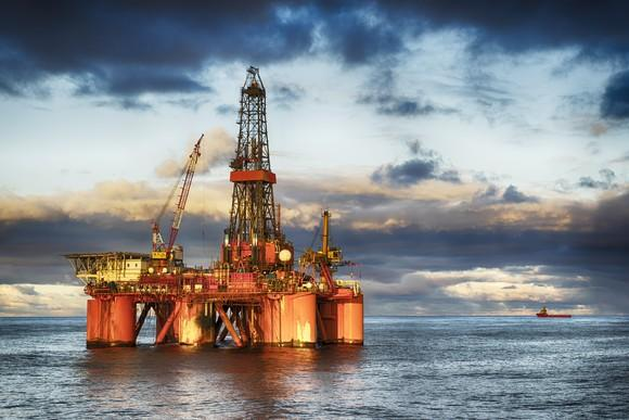 An offshore oil rig in the water