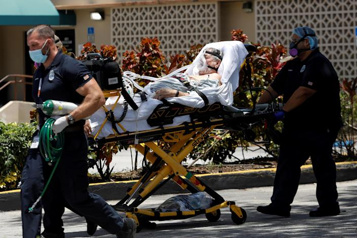 Emergency Medical Technicians (EMT) leave with a patient at Hialeah Hospital where the coronavirus disease (COVID-19) patients are treated, in Hialeah, Florida, U.S., July 29, 2020. REUTERS/Marco Bello TPX IMAGES OF THE DAY