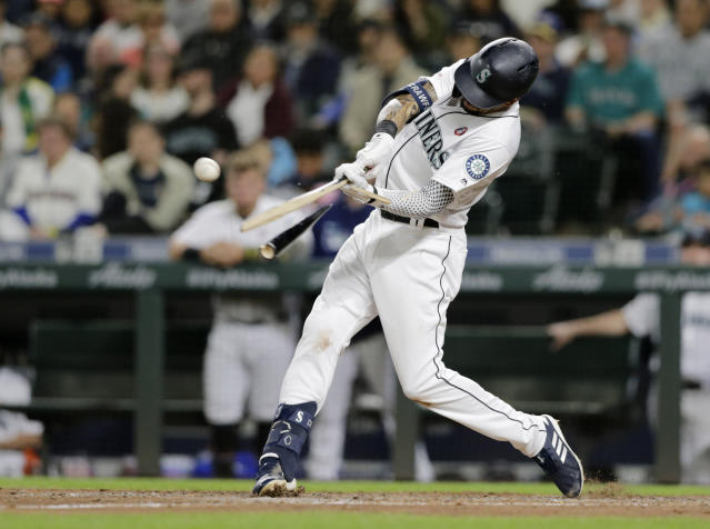 Seattle Mariners' J.P. Crawford breaks his bat on an RBI single against the Minnesota Twins during the fifth inning of a baseball game Saturday, May 18, 2019, in Seattle. (AP Photo/John Froschauer)