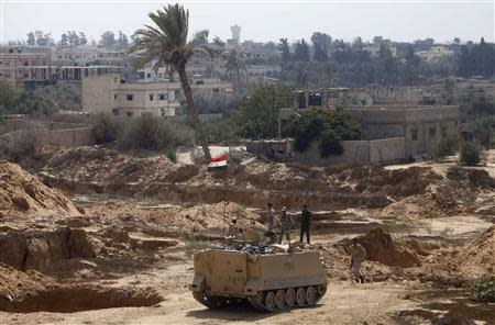Egyptian soldiers keep guard on the border between Egypt and the southern Gaza Strip