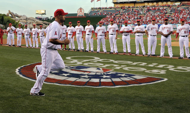 Los Angeles Angels' Albert Pujols runs out during introductions prior to a baseball game against the Kansas City Royals, Friday, April 6, 2012, in Anaheim, Calif. (AP Photo/Mark J. Terrill)