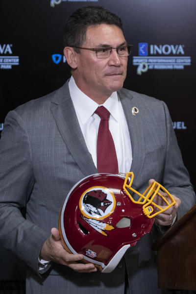 Washington Redskins new head coach Ron Rivera holds up a helmet during a news conference at the team's NFL football training facility, Thursday, Jan. 2, 2020 in Ashburn, Va. (AP Photo/Alex Brandon)