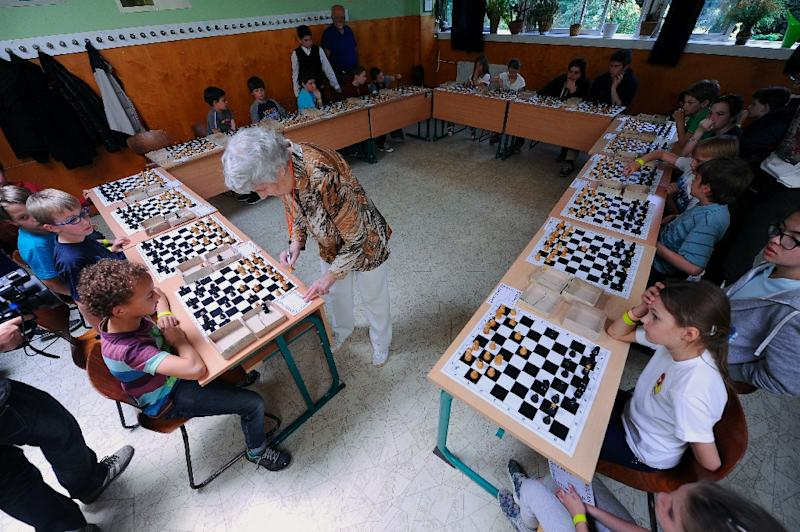 Hungarian pensioner Brigitta Sinka, 87, plays simultaneous chess games at Budenz school in Budapest on May 31, 2015 -- she is on the brink of setting a world record by beating 1920s Cuban chess grandmaster Juan Capablanca (AFP Photo/Attila Kisbenedek)