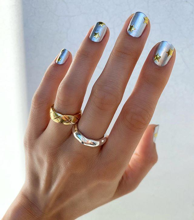 """<p>Can't decide between silver and gold? You don't have to with this glamorous, star-studded manicure. Perfect for a festive occasion, or just anytime you need a little extra shine. </p><p><a class=""""body-btn-link"""" href=""""https://www.amazon.com/ALLYDREW-Glitter-Stickers-Sparkly-sheets/dp/B072MJZ8TS/?tag=syn-yahoo-20&ascsubtag=%5Bartid%7C10055.g.29072953%5Bsrc%7Cyahoo-us"""" target=""""_blank"""">SHOP STAR NAIL STICKERS</a></p><p><a href=""""https://www.instagram.com/p/CDSLLXljrBl/&hidecaption=true"""">See the original post on Instagram</a></p>"""