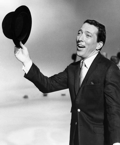 "FILE - In a May 12, 1961 file photo, Andy Williams performs a song on a television show. Emmy-winning TV host and ""Moon River"" crooner Williams died Tuesday night, Sept, 25, 2012 at his home in Branson, Mo., following a year-long battle with bladder cancer. He was 84. (AP Photo, File)"