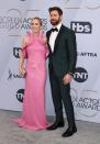 <p>Emily Blunt and John Krasinski left their two daughters at home for a date night at the SAGs. Blunt, wearing a custom Michael Kors dress, is a double nominee, up for Outstanding Performance by a Female Actor in a Leading Role for <em>Mary Poppins Returns</em> and Outstanding Performance by a Female Actor in a Supporting Role for her work in <em>A Quiet Place</em>. Meanwhile, Krasinski looked dapper in custom Isaia. (Photo: Getty Images) </p>
