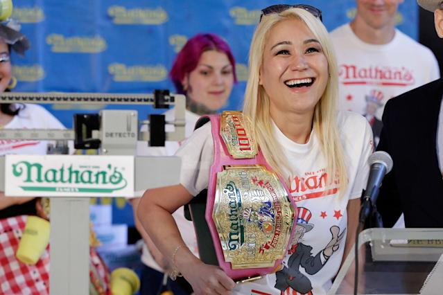 <p>Current women's champion Miki Sudo, of Las Vegas, holds her championship belt during the weigh-in for the 2017 Nathan's Hot Dog Eating Contest, in Brooklyn Borough Hall, in New York, Monday, July 3, 2017. Ms. Suto weighed-in at 126 pounds. (AP Photo/Richard Drew) </p>
