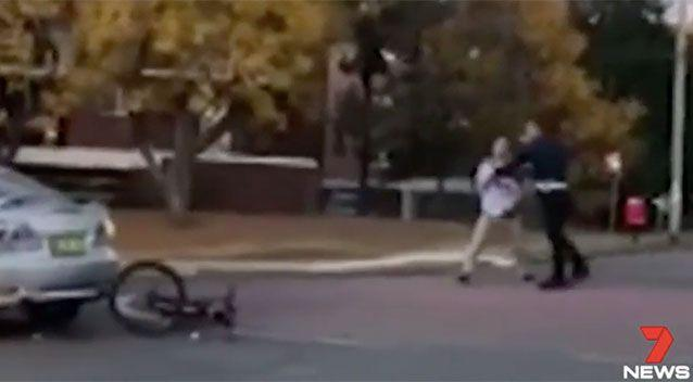 The cyclist (left) and driver (right) tussle in an attempted citizen's arrest. Source: 7 News