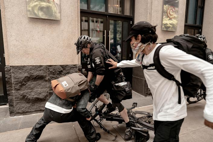 Police in downtown Seattle used physical force to detain a protester on May 31, 2020. (Carl Marcel)