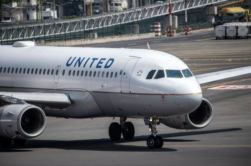 A United Airlines plane prepares to take off at the Benito Juarez International airport in Mexico City