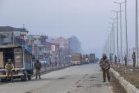 Indian paramilitary soldiers stand guard on a road leading towards the site of a gun battle on the outskirts of Srinagar, Indian controlled Kashmir, Wednesday, Dec. 30, 2020. A gun battle between rebels and government forces overnight killed three rebels on the outskirts of Srinagar on Wednesday, officials said. (AP Photo/ Dar Yasin)