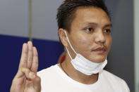 Pyae Lyan Aung, a member of the Myanmar national team who raised a three-finger salute during a qualifying match for the 2022 World Cup in late May, gestures as he arrived at Kansai International Airport in Osaka Prefecture, Japan on Thursday June 17, 2021. Pyae Lyan Aung has refused to return home and is seeking asylum, a request the government was considering taking into account unrest in his country following a coup. (Kyodo News via AP)