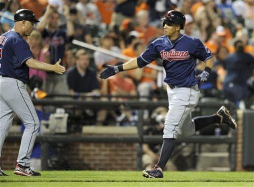 Cleveland Indians' Michael Brantley, right, rounds the bases after he hit a two-run home run as he is greeted by third base coach Brad Mills, left, during the eighth inning of a baseball game against the Baltimore Orioles, Monday, June 24, 2013, in Baltimore. The Indians won 5-2. (AP Photo/Nick Wass)