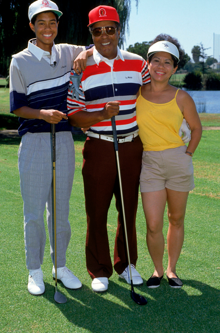 Tiger Woods poses for a photograph with his father, Earl, and mother, Kultida, in September 1990.