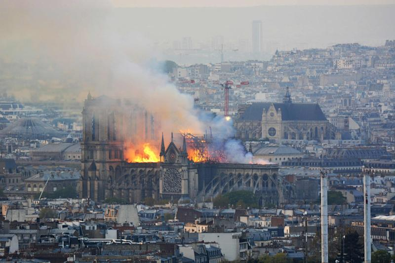 Smoke and flames rise during a fire at the landmark Notre Dame Cathedral in central Paris (AFP/Getty Images)